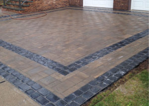 paver driveway installation with border in bergen county