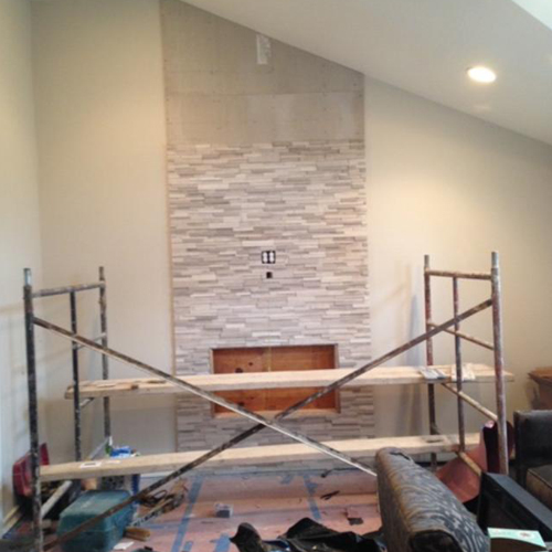 Stone fireplace in progress photo